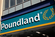 Sign for the pound shop and discount brand Poundland in Birmingham, United Kingdom.