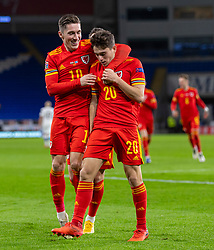 CARDIFF, WALES - Wednesday, November 18, 2020: Wales' Daniel James (R) celebrates with team-mate Harry Wilson after scoring the second goal during the UEFA Nations League Group Stage League B Group 4 match between Wales and Finland at the Cardiff City Stadium. Wales won 3-1 and finished top of Group 4, winning promotion to League A. (Pic by David Rawcliffe/Propaganda)