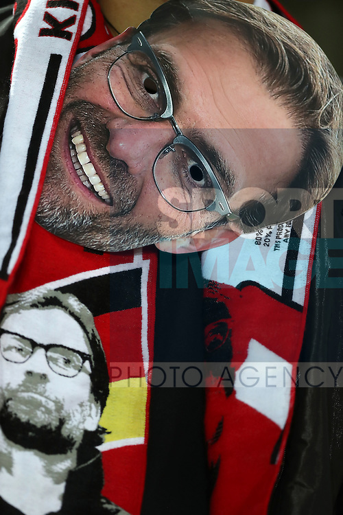 Liverpool fans with Jurgen Klopp manager of Liverpool masks before the English Premier League match at Anfield Stadium, Liverpool. Picture date: December 31st, 2016. Photo credit should read: Lynne Cameron/Sportimage