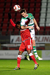 Yeovil Town Jamie McAllister wins the ball in the air against Leyton Orient's Moses Odubajo - Photo mandatory by-line: Dougie Allward/JMP - Tel: Mobile: 07966 386802 09/01/2013 - SPORT - FOOTBALL - Matchroom Stadium - London -  Leyton Orient v Yeovil Town - Johnstone's Paint Trophy Southern area semi-final.