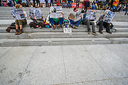 Activists performing to read the newspaper dailies outside National Gallery on the first day of the environmental activist group Extinction Rebellion (XR) protest in Trafalgar Square, central London on Monday, Aug 23, 2021. The movement launched a two-week protest campaign to demand that the government take greater action to address climate change. (VX Photo/ Vudi Xhymshiti)