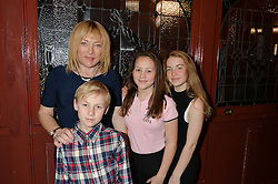 KELLIE MALONEY, EUGENE MALONEY (nephew) ISABELLE MALONEY (niece) and LIBBY MALONEY (daughter) at the opening night of Cinderella at The New Wimbledon Theatre, 93 The Broadway, London SW19 1QG on 9th December 2014.