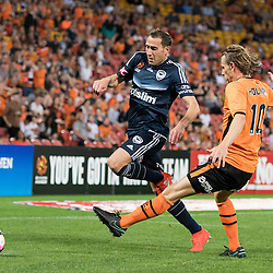 BRISBANE, AUSTRALIA - OCTOBER 7: Brett Holman of the Roar tackles Alan Baro of the Victory during the round 1 Hyundai A-League match between the Brisbane Roar and Melbourne Victory at Suncorp Stadium on October 7, 2016 in Brisbane, Australia. (Photo by Patrick Kearney/Brisbane Roar)