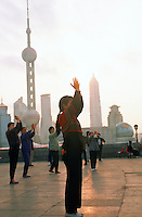 Early morning exercisers in Huangpu Park (Pudong in background), Shanghai, China