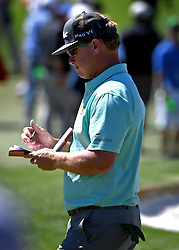 Charley Hoffman looks over his yardage book as he walks to the 3rd tee box during the third round of the Masters Tournament at Augusta National Golf Club in Augusta, Ga., on Saturday, April 8, 2017. (Photo by Jeff Siner/Charlotte Observer/TNS) *** Please Use Credit from Credit Field ***