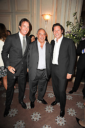 Left to right, TIM JEFFERIES, SIR PHILLIP GREEN and ARKI BUSSON at a dinner hosted by Vogue in honour of photographer David Bailey at Claridge's, Brook Street, London on 11th May 2010.