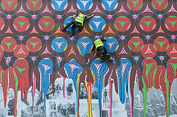 "© Licensed to London News Pictures. 16/05/2016. London, UK. A specialist team of abseilers hang down the façade of the Royal Academy of Arts' Burlington Gardens building in Mayfair, adding the final touches to a monumental public artwork called ""RA Family Album, 2016"" by internationally renowned artist Yinka Shonibare RA.  The artwork covers the scaffolding on the façade as part of the RA's transformative redevelopment which will be completed in time for its 250th anniversary in 2018.  Photo credit : Stephen Chung/LNP"