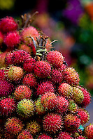a bunch of ripe rambutans bunched and tied together ready for sale