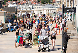© Licensed to London News Pictures; 25/05/2020; Weston-super-Mare, UK. General views today of crowds on Weston's beach and promenade on a spring bank holiday Monday. Weston General Hospital has said it is temporarily closed to new admissions including for A&E due to the high number of Covid-19 coronavirus patients it is caring for in the hospital. Last week there was concern in Weston-super-Mare about the high number of visitors to the beach and seafront during the warm weather. Photo credit: Simon Chapman/LNP.
