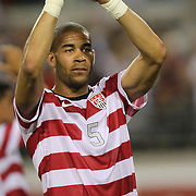 United States Defenseman Oguchi Onyewu (5) salutes the crowd after an international friendly soccer match between Scotland and the United States at EverBank Field on Saturday, May 26, 2012 in Jacksonville, Florida.  The United States won the match 5-1 in front of 44,000 fans. (AP Photo/Alex Menendez)