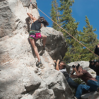 Members of a photography workshop photograph rock climbers near Banff in Banff National Park, Alberta, Canada.