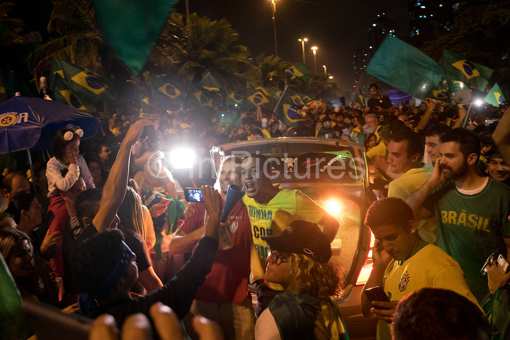 Supporters gather to celebrate as far right candidate Jair Bolsonaro was announced as the next President of Brazil, winning the election with a 55% majority on Sunday 28th October in Rio de Janeiro, Brazil. Outside his house in Barra de Tijuca, Rio de Janeiro, thousands of his supporters celebrate with fireworks and Brazil flags. (Photo by Phil Clarke Hill/In Pictures for Getty Images)