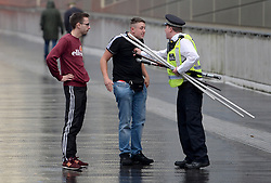 Police exchange words with fans prior to the match