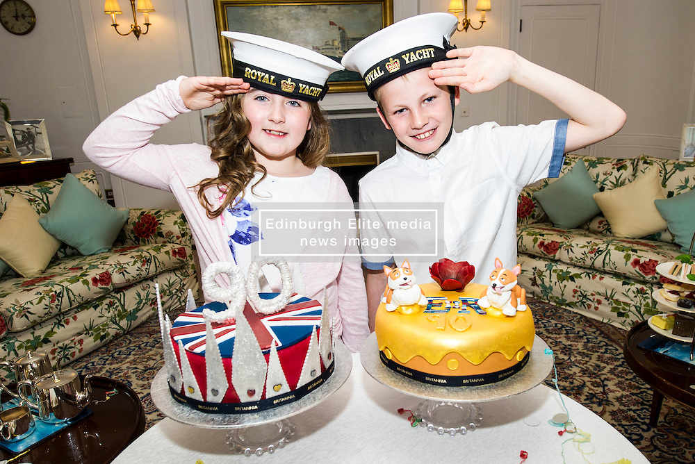 """Pictured: Lucy Kearney (8) and Alfie Bennet (11)<br /> <br /> Chefs Tom Kitchin and Vicki Tighe presented primary pupils Alfie Bennet and Lucy Kearney with nine-inch versions of their winning entries for the """"Design a Cake for The Queen's 90th Birthday"""" competition on the Royal Yacht Britannia today. <br /> Ger Harley 