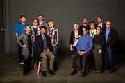 Group photo of entrepreneurs in Northwest Arkansas.<br /> <br /> Left Group: Choung Nguyen (solid blue shirt), Stan Zylowsky (blue sweater), Kenny Carson (blue/yellow plaid), Douglass Hutchings (red/black plaid) Fran Free (gray sweater), Anthony Cruz (blazer, tie)<br /> <br /> Right Group: Michael Paladino (black shirt/glasses), Kurt Lind (blazer, tan shirt), April Seggebruch (blonde hair on left), Randy Walker (tan blazer), Chris Taylor (blue stripe, glasses, blazer), Calvin GoForth(blue stripe shirt, seated), Barbara Taylor (black shirt)<br /> <br /> Photo by Beth Hall