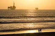 Couple Walking at Sunset in Huntington Beach