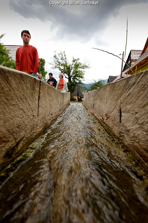 Water runs through a wood pipe in Vilkolinec, Slovakia on Wednesday July 6th 2011.  (Photo by Brian Garfinkel)