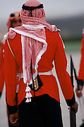 Military armed guard in ceremonial uniform with keffiyeh headdress for VIP arrival at Dubai International airport