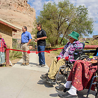 Navajo Nation Zoo Manager David Mikesic and Arval McCabe of Navajo Nation Tourism Development speak during a ribbon cutting for new concrete walkways at the Navajo Nation Zoo in Window Rock Thursday.