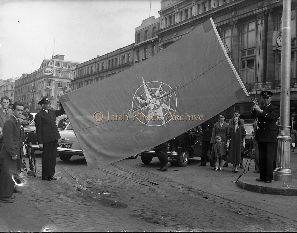 Aer Lingus 21st Anniversary Flag being Hoisted on O'Connell Street, Dublin Ireland. 27/05/1957<br /> <br /> Father L.F. Kelly blesses aircraft and new Aer Lingus house flag to celebrate the airline's 21st anniversary.