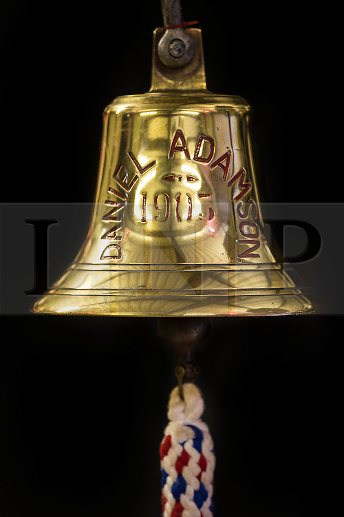 """© Licensed to London News Pictures. 04/05/2016. Birkenhead UK. Picture shows the Bell of the Daniel Adamson during restoration work at the Canada Dock volunteer workshop. The Daniel Adamson steam boat has been bought back to operational service after a £5M restoration. The coal fired steam tug is the last surviving steam powered tug built on the Mersey and is believed to be the oldest operational Mersey built ship in the world. The """"Danny"""" (originally named the Ralph Brocklebank) was built at Camel Laird ship yard in Birkenhead & launched in 1903. She worked the canal's & carried passengers across the Mersey & during WW1 had a stint working for the Royal Navy in Liverpool. The """"Danny"""" was refitted in the 30's in an art deco style. Withdrawn from service in 1984 by 2014 she was due for scrapping until Mersey tug skipper Dan Cross bought her for £1 and the campaign to save her was underway. Photo credit: Andrew McCaren/LNP ** More information available here http://tinyurl.com/jsucxaq **"""