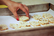 Preparing Biscotti (Prato biscuits), twice-baked biscuits originating in Italy