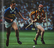 Tipperary's Declan Carr in a race with Kilkenny's Canice Brennan in the 1991 final.