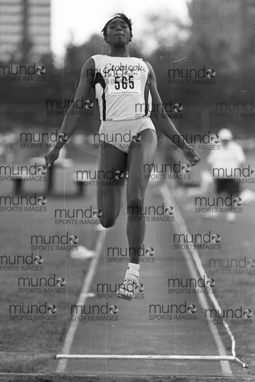 (Ottawa, Canada---07 July 1993) Nicole Devonish in the long jump at the 1993 FISU World Student Games track and field team trials held at the Terry Fox Athletic Facility. Photograph copyright 1993 Sean Burges / Mundo Sport Images<br /> <br /> *****NOTE -- contact us if you want this file cleaned up before you purchase it. It takes a while to adjust each B&W image and so we have not comprehensively cleaned all B&W files before uploading them **********