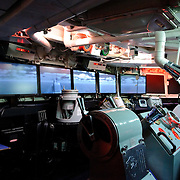 Display of the command deck of the HMAS Brisbane at the Australian War Memorial in Canberra. The HMAS Brisbane (D 41) was a Perth class guided missile destroyer, built in the United States of America and commissioned into the Royal Australian Navy (RAN) in 1967. She served in the Vietnam War and during the 1991 Gulf War (as part of Operation Damask).<br /> Brisbane was decommissioned in 2001, and was sunk as a dive wreck off the Queensland coast. The command deck was saved for the exhibit.