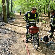 NLD/Huizen/20100429 - Heidebrand Ericaweg Huizen, brandweer op de fiets