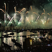 VENICE, ITALY - JULY 16: Reflections on the fireworks and gondolas are seen in St Mark's basin at the end of the first day of Redentore celebrations on July 16, 2011 in Venice, Italy. Redentore is one of the most loved celebrations by Venetians which is a remembrance of the end of the 1577 plague. Highlights of the celebration include the pontoon bridge extending across the Giudecca Canal, gatherings on boats in the St Mark's basin and spectacular fireworks on display.