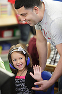 """Chorley Elementary School kindergarten student Samantha Pupo high fives her father Leo Pupo after she put the right letter in the right place on the computer during """"Bring Your Kids to Kindergarten Day"""" in Middletown on Thursday, Sept. 6, 2012."""