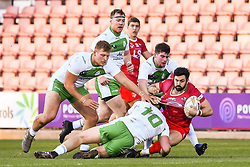11th November 2018 , Racecourse Ground,  Wrexham, Wales ;  Rugby League World Cup Qualifier,Wales v Ireland ; Rhys Williams of Wales is tackled by Liam Byrne of Ireland <br /> <br /> <br /> Credit:   Craig Thomas/Replay Images