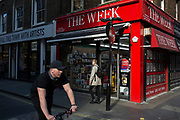 Street Scene in Soho of a newsagents branded with The Week sign, London, England, United Kingdom.