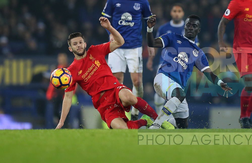 Adam Lallana of Liverpool and Idrissa Gueye of Everton during  the English Premier League match at Goodison Park, Liverpool. Picture date: December 19th, 2016. Photo credit should read: Lynne Cameron/Sportimage