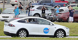 Fans wave as SpaceX Demo-2 astronauts Doug Hurley Photo by visible) and Bob Behnken are driven to the launch complex at Kennedy Space Center, FL, USA, Wednesday, May 27, 2020. Afternoon thunderstorms are a concern for the scheduled launch time at 4:33pm of the Space X Falcon 9 carrying the two astronauts in the Crew Dragon capsule. Photo by Joe Burbank/Orlando Sentinel/TNS/ABACAPRESS.COM
