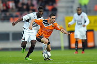 FOOTBALL - FRENCH CHAMPIONSHIP 2009/2010 - L1 - FC LORIENT v STADE RENNAIS - 10/04/2010 - PHOTO PASCAL ALLEE / DPPI - MORGAN AMALFITANO (FCL) / ALEXANDER TETTEY (REN)