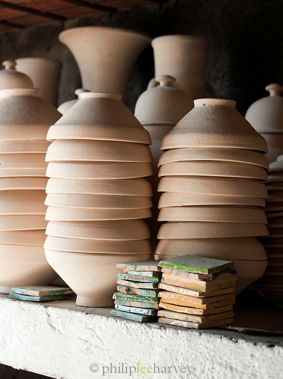 Pottery waiting to be decorated at an artisanal workshop in Fes, Morocco