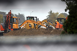 March 18, 2019 - Christchurch, New Zealand - Workers dig graves at at a Muslim cemetery in Christchurch, New Zealand on March 17, 2019, for victims of  mass shooing. At least 50 people were killed and 36 injured in mass shootings at two mosques in the New Zealand city of Christchurch Friday, 15 March. A 28-year-old Australian born man appeared in Christchurch District Court on Saturday charged with murder. (Credit Image: © Sanka Vidanagama/NurPhoto via ZUMA Press)