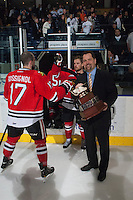 KELOWNA, CANADA - APRIL 25: Karl Taylor, assistant coach of the Portland Winterhawks holds the Western Conference trophy as the players exit the ice on April 25, 2014 during Game 5 of the third round of WHL Playoffs at Prospera Place in Kelowna, British Columbia, Canada. The Portland Winterhawks won 7 - 3 and took the Western Conference Championship for the fourth year in a row earning them a place in the WHL final.  (Photo by Marissa Baecker/Getty Images)  *** Local Caption *** Karl Taylor;