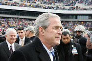 6 Dec 2008: President George W Bush walks off the field into the stands before the Army / Navy game December 6th, 2008. At Lincoln Financial Field in Philadelphia, Pennsylvania.