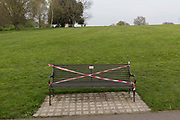 As the UK Prime Minister Boris Johnson suffers from Coronavirus and remains in intensive care in hospital - and a record 938 UK daily deaths were recorded, a total of 7,097, benches are taped to stop the public from using them, in Brockwell Park that was recently closed after 3,000 park users forced Lambeth council to completely close the south London green space, on 8th April 2020, in south London, England.