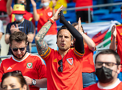 CARDIFF, WALES - Saturday, June 5, 2021: A Wales supporter sings the national anthem before an International Friendly between Wales and Albania at the Cardiff City Stadium in their game before the UEFA Euro 2020 tournament. (Pic by David Rawcliffe/Propaganda)