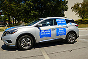 "24 JULY 2020 - DES MOINES, IOWA: A teacher drives around the Iowa State Capitol during a motorcade to protest the reopening of the schools. Hundreds of teachers from across Iowa came to the state capitol Friday to protest Governor Kim Reynolds' order that school must reopen with in person education and minimized the potential for ""distance learning."" The event was one of the largest COVID-19 protests in Iowa since the pandemic started, more than 740 teachers signed up to attend the protest. After the protest officially ended, many teachers left the capitol and drove to Gov. Reynolds' residence, where they drove around her mansion and honked horns. Some people left notes on the entrance to the governor's residence. Gov. Reynolds ordered the school reopening last week, but according to teachers, the state has not implemented health guidelines or bought protective equipment like face masks in the quantity required to slow the spread of the Coronavirus (SARS-CoV-2). Iowa's numbers of COVID-19 infections are up statewide.          PHOTO BY JACK KURTZ"