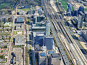 Nederland, Noord-Holland, Amsterdam; 17-04-2021; Zuidas met in het midden de Strawinskylaan, links de Prinses Irenestraat. Rechts station Zuid-WTC, het Zuidasdok en autosnelweg Ring A10.<br /> Zuidas with the Strawinskylaan, the Prinses Irenestraat on the left. On the right, Zuid-WTC railway station, the Zuidasdok and the Ring A10 motorway.<br /> luchtfoto (toeslag op standaard tarieven);<br /> aerial photo (additional fee required)<br /> copyright © 2021 foto/photo Siebe Swart