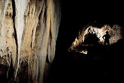 Speleologist in a cave near Castro