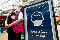 Edinburgh, Scotland, UK. 21 June, 2020. On Monday 22 June it will be mandatory for passengers to wear face coverings when travelling on railways in Scotland. Waverley Station in Edinburgh is preparing by installing warning signs and advisory notices through the station. Many customer service assistants are also on duty to advise the travelling public.   Iain Masterton/Alamy Live News