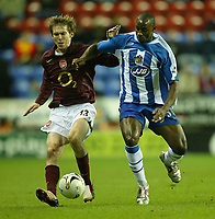 Photo: Aidan Ellis.<br /> Wigan Athletic v Arsenal. Carling Cup. Semi Final, 1st Leg.<br /> 10/01/2006.<br /> Wigan's Jason Roberts battles with Arsenal's Alexander Hleb