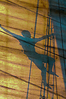 Silhouette of a crew member climbing the mast of the schooner Western Union, off Key West, Florida Keys, Florida USA