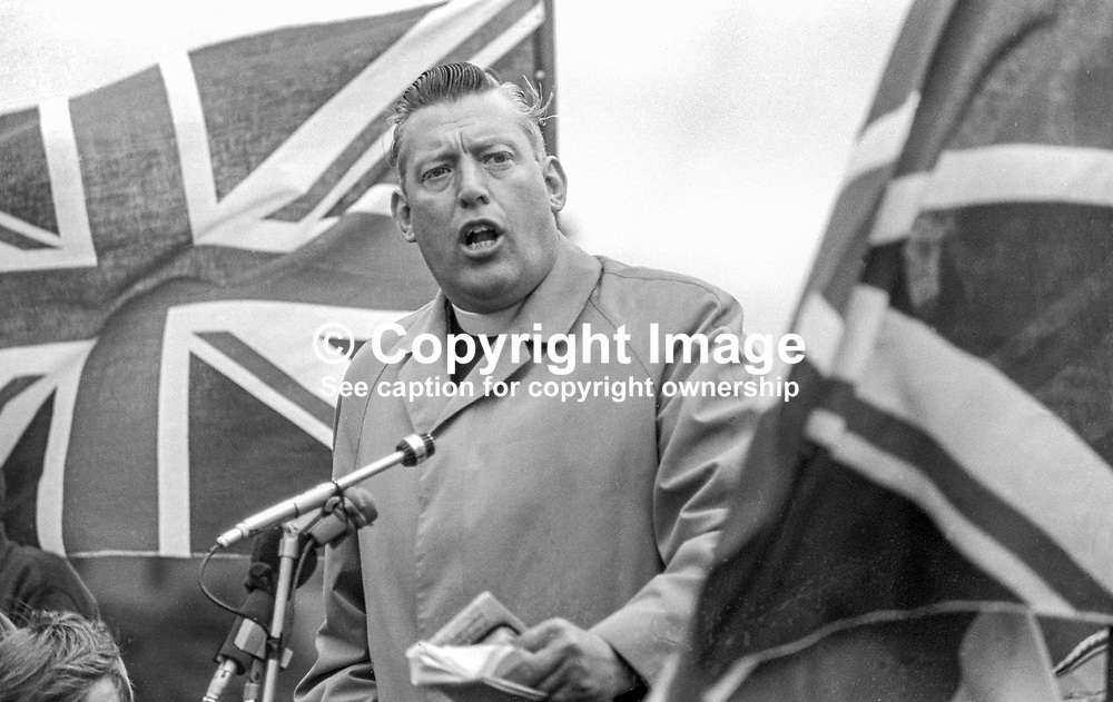 Rev Ian Paisley MP speaking at Independent Orange Order's annual demonstration at Knocknagoney, near Belfast. 1970071110255e, 255/70.<br /> <br /> Copyright Image from Victor Patterson, Belfast, UK<br /> <br /> t: +44 28 9066 1296 (from Rep of Ireland 048 9066 1296)<br /> m: +44 7802 353836<br /> e: victorpattersonbelfast@gmail.com<br /> <br /> www.images4media.com<br /> <br /> Please see my full Terms and Conditions of Use at https://www.images4media.com/p/terms-conditions - it is IMPORTANT that you familiarise yourself with them.<br /> <br /> Images used online incur an additional cost. This cost should be agreed in writing in advance. Online images must be visibly watermarked i.e. © Victor Patterson or that of the named photographer within the body of the image. The original metadata must not be deleted from images used online.<br /> <br /> This image is only available for the use of the download recipient i.e. television station, newspaper, magazine, book publisher, etc, and must not be passed on to a third party. It is also downloaded on condition that each and every usage is notified within 7 days to victorpattersonbelfast@gmail.com.<br /> <br /> The right of Victor Patterson (or the named photographer) to be identified as the author is asserted in accordance with The Copyright Designs And Patents Act (1988). All moral rights are asserted.